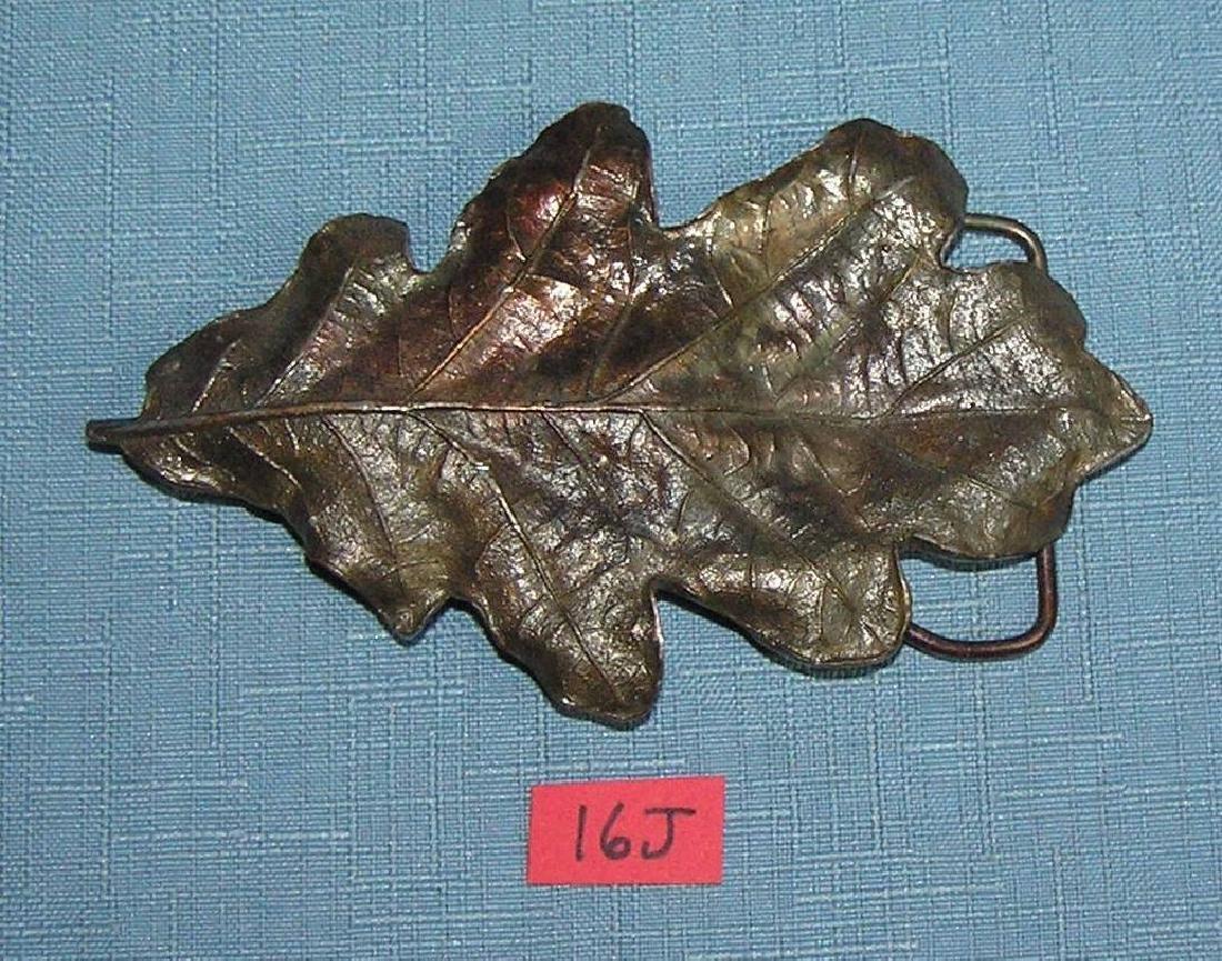 Leaf shaped brass belt buckle