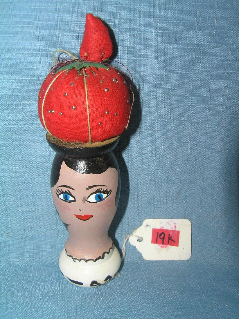 Hand painted wooden pin cusion doll
