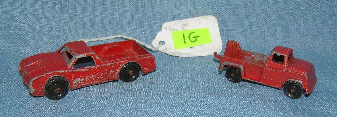 Pair of early cast metal midgit toy trucks