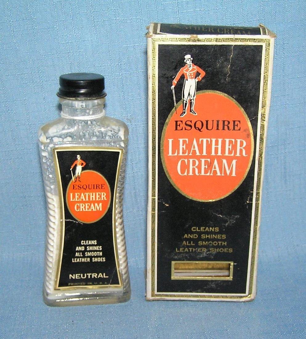 Early Esquire leather cream glass bottle