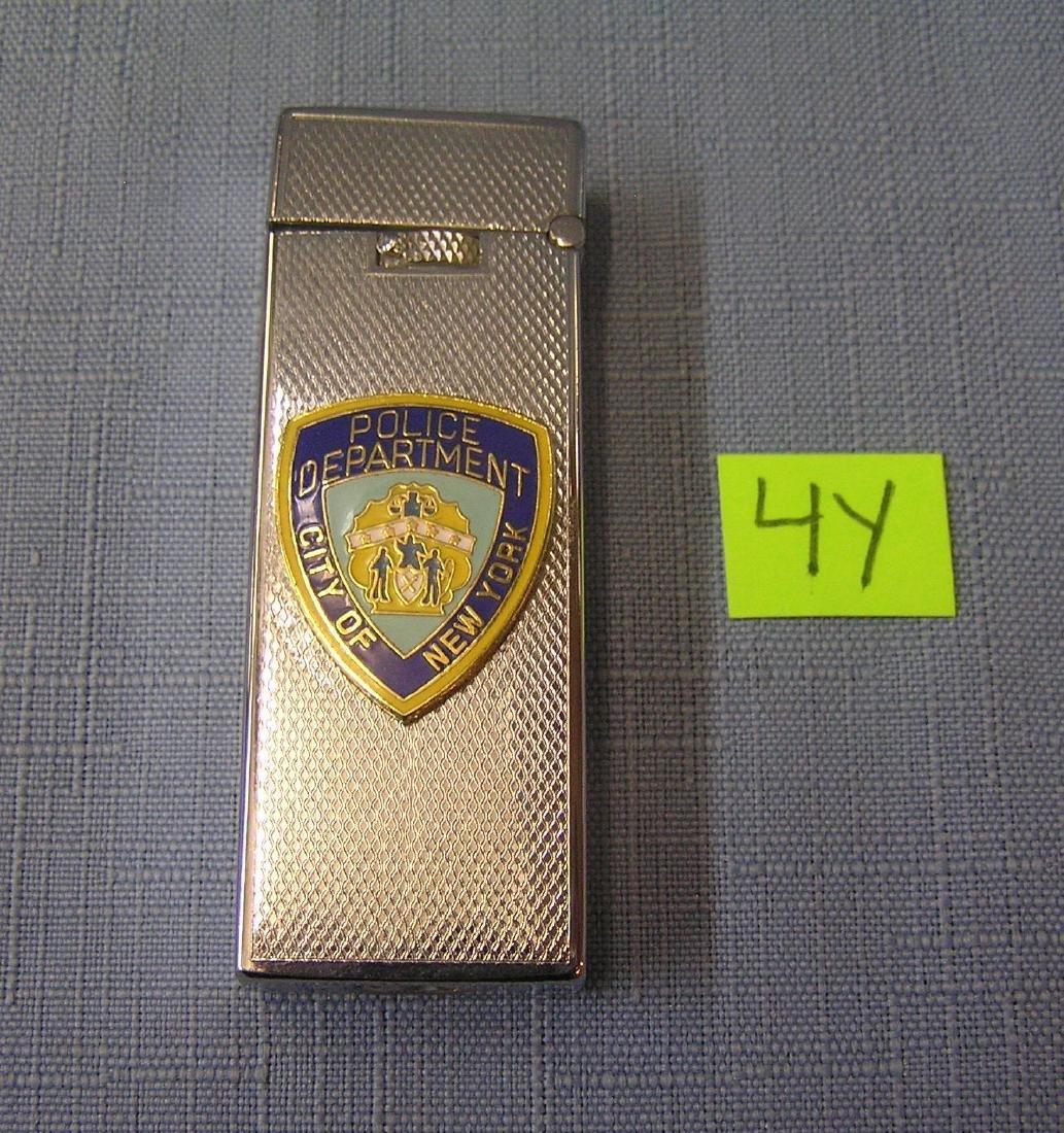 Vintage NY City police butane lighter