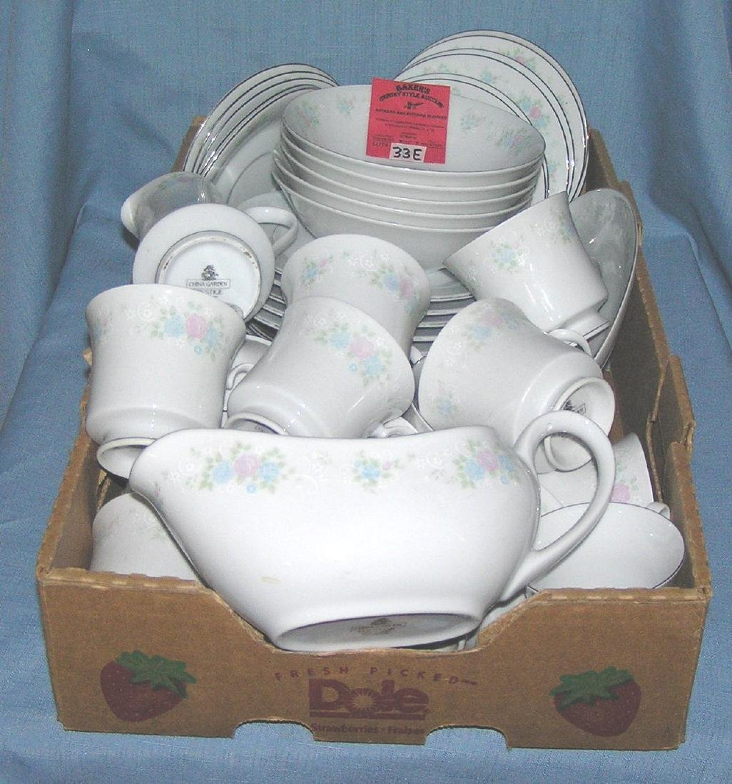 Large box full of floral decorated dinnerware by China