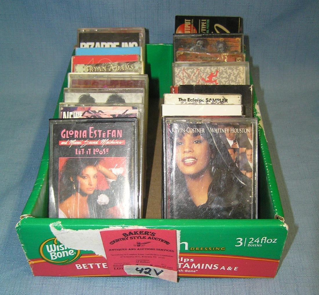 Box full of vintage musical cassette tapes
