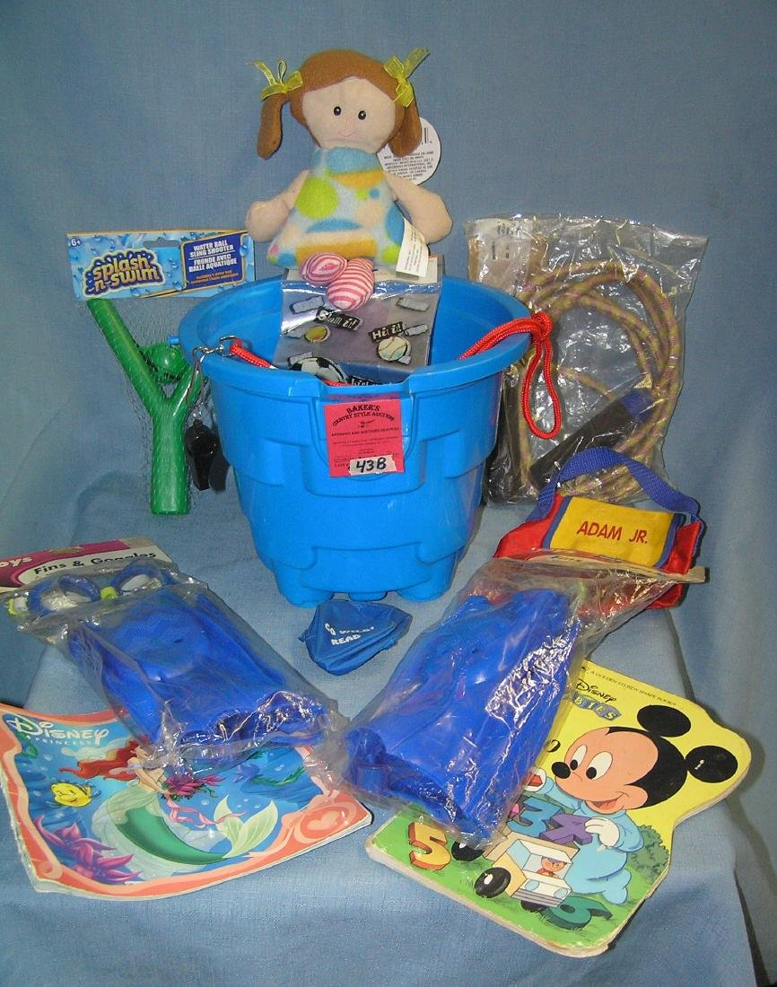 Large pail full of vintage and modern children's toys