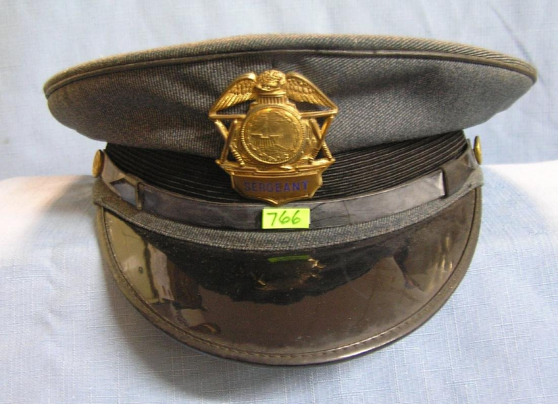Early police sergeant visor cap and shield