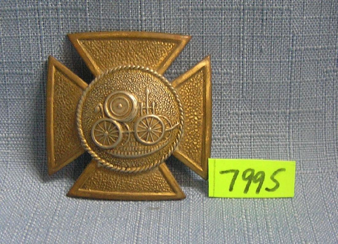 Early horse drawn steam pump badge