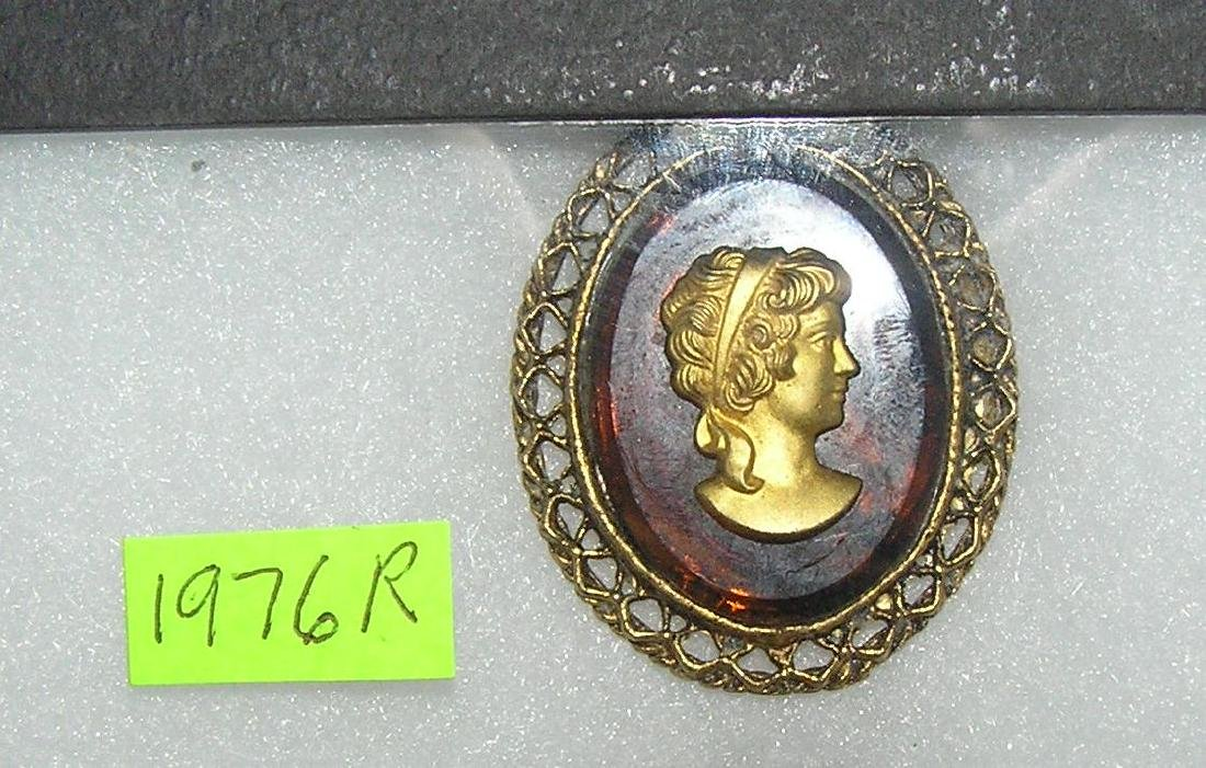 Cameo style pin on amnber colored Bakelite