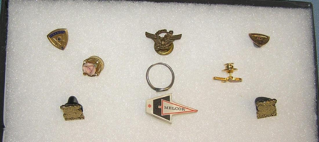 Group of vintage pins and awards