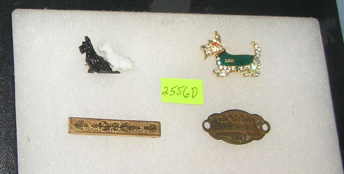 Pair of dog pins, 1941 dog license and bar pin