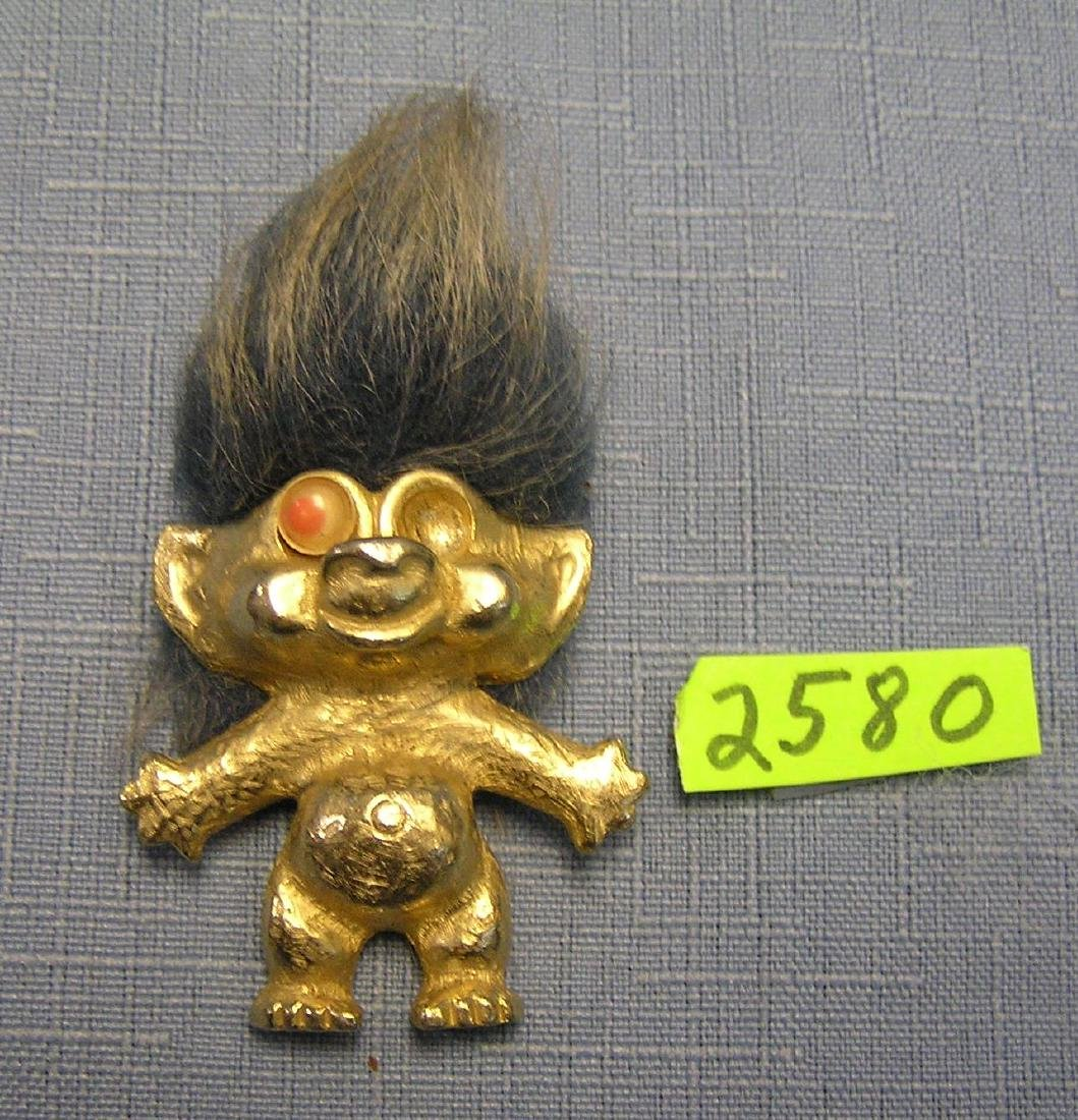 Early all cast metal googily eyed figural troll pin