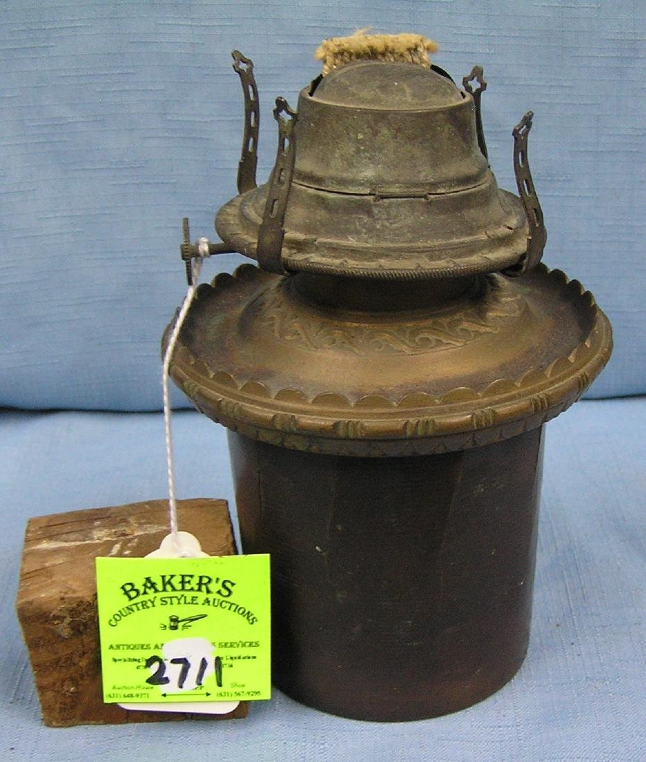 Antique oil lamp by Banner