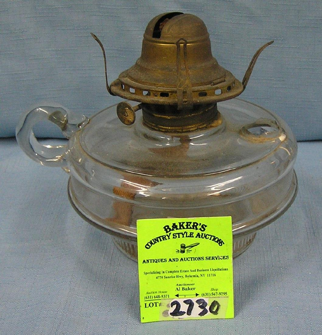 Glass and brass oil lamp