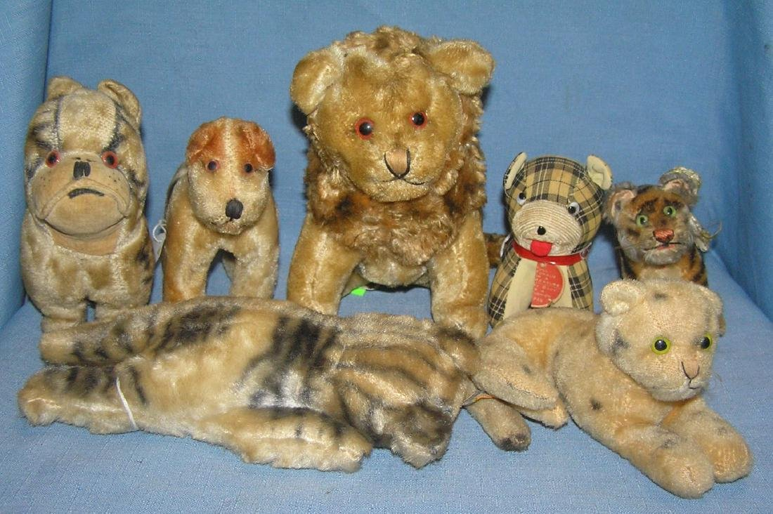 Group of 7 antique straw filled stuffed animals
