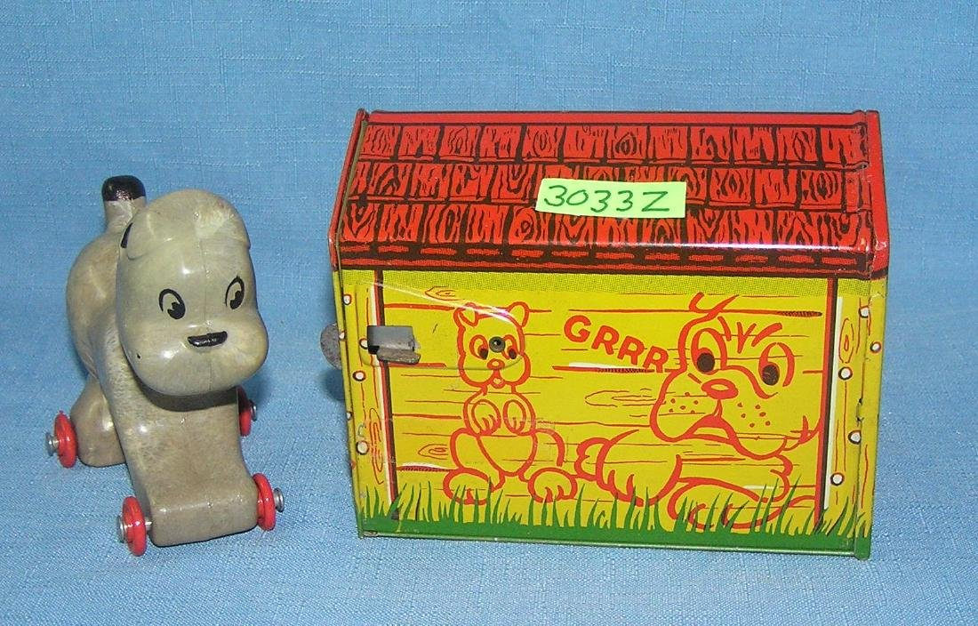 Pooch the Pop Out Pup tin mech. toy ca. 1930's