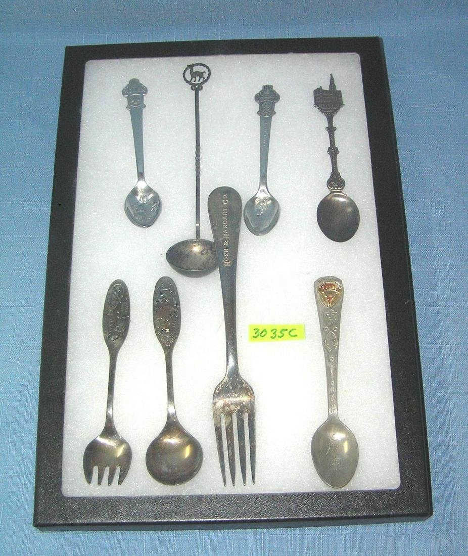 Collection of souvenir spoons and fork