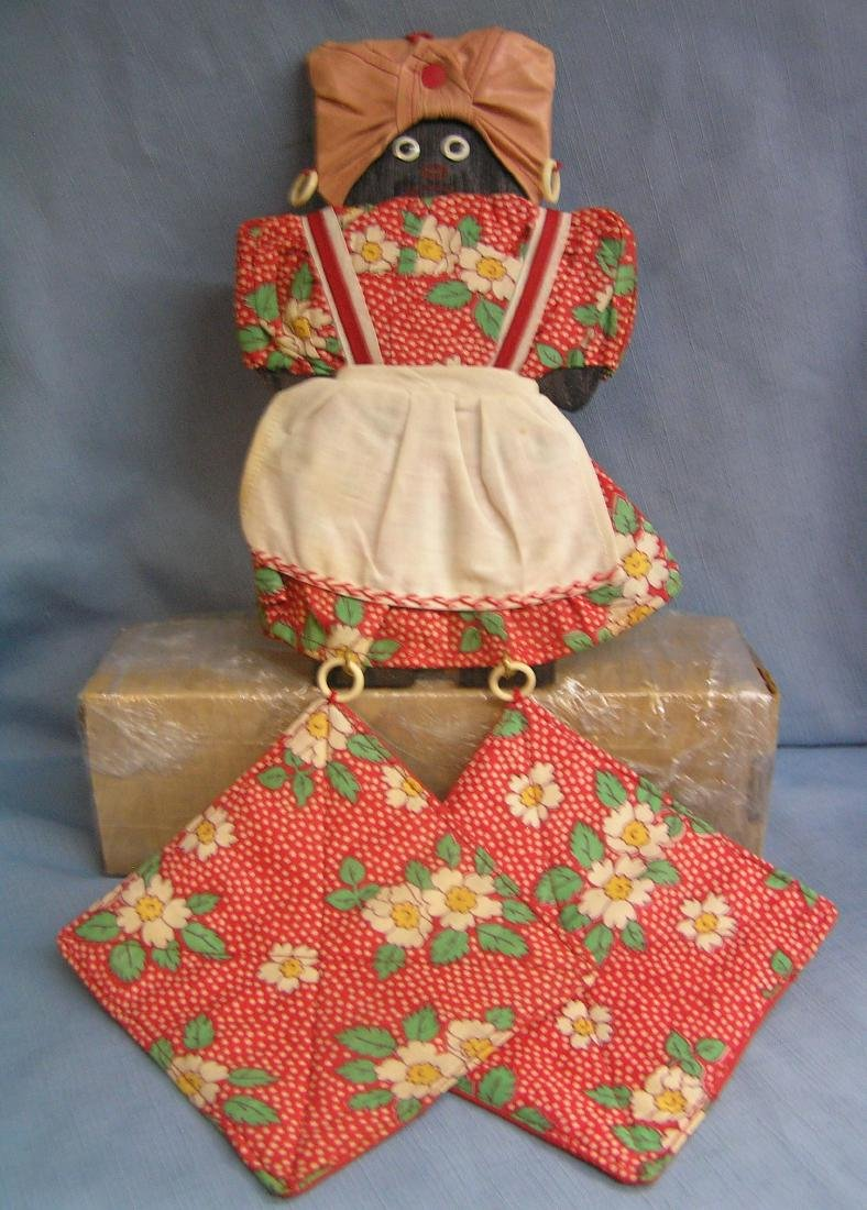 Early Black Mammy pot holder wall display