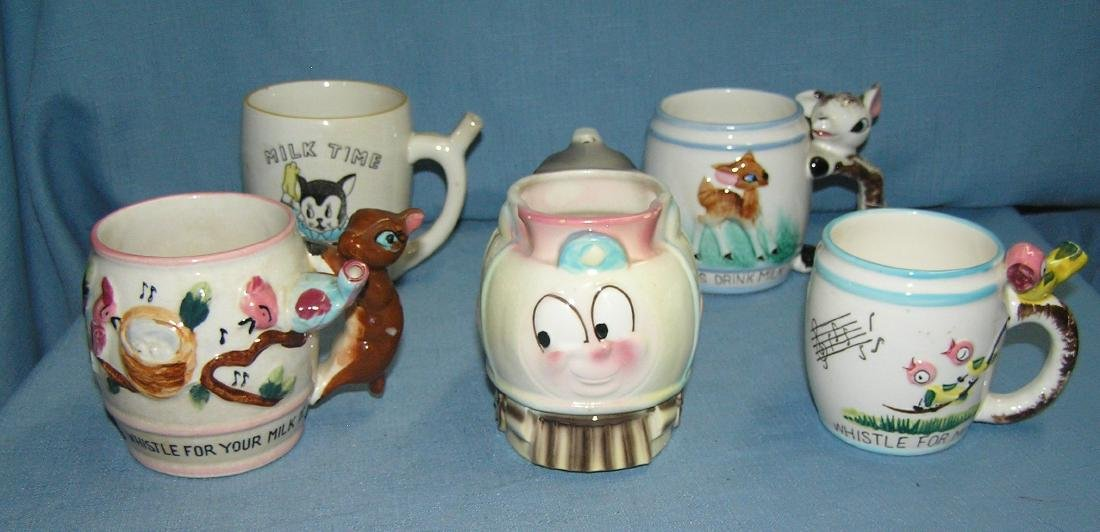 Group of 5 porcelain children's milk mugs