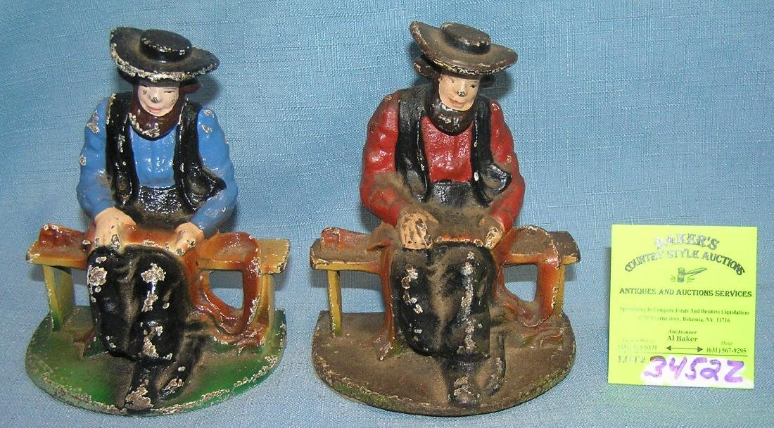 Cast iron figural book ends/paper weights
