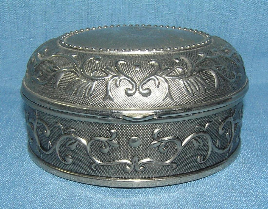 Oval shaped decorated cast metal jewelry box