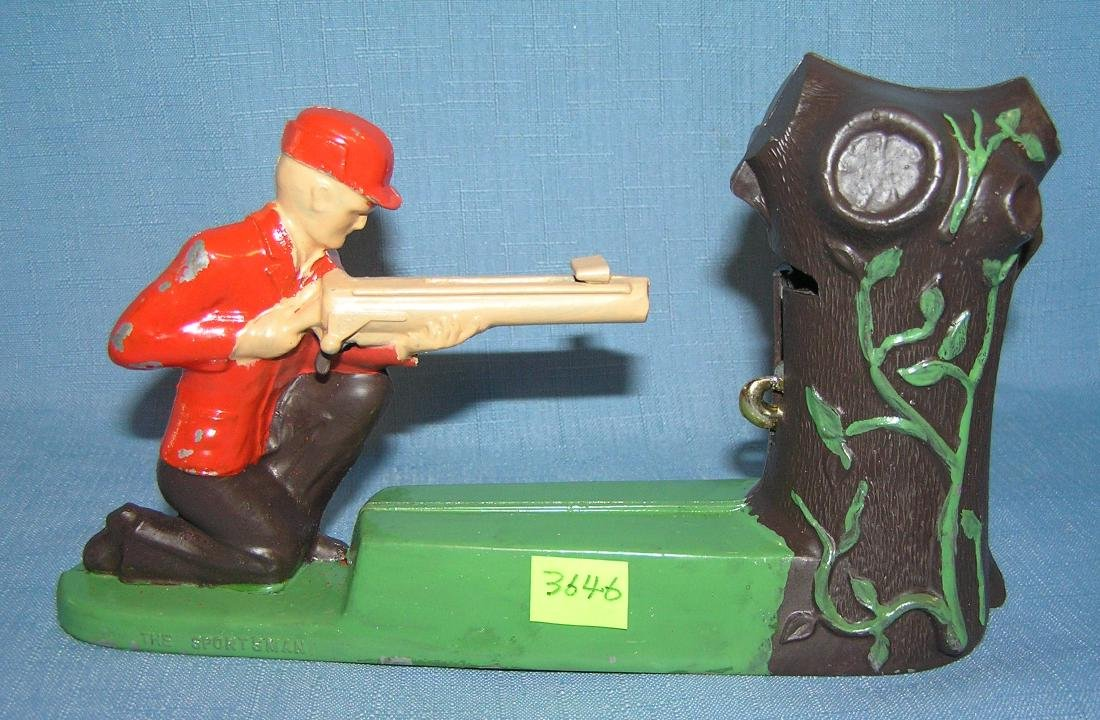 Vintage Sportsman mechanical shooting coin bank