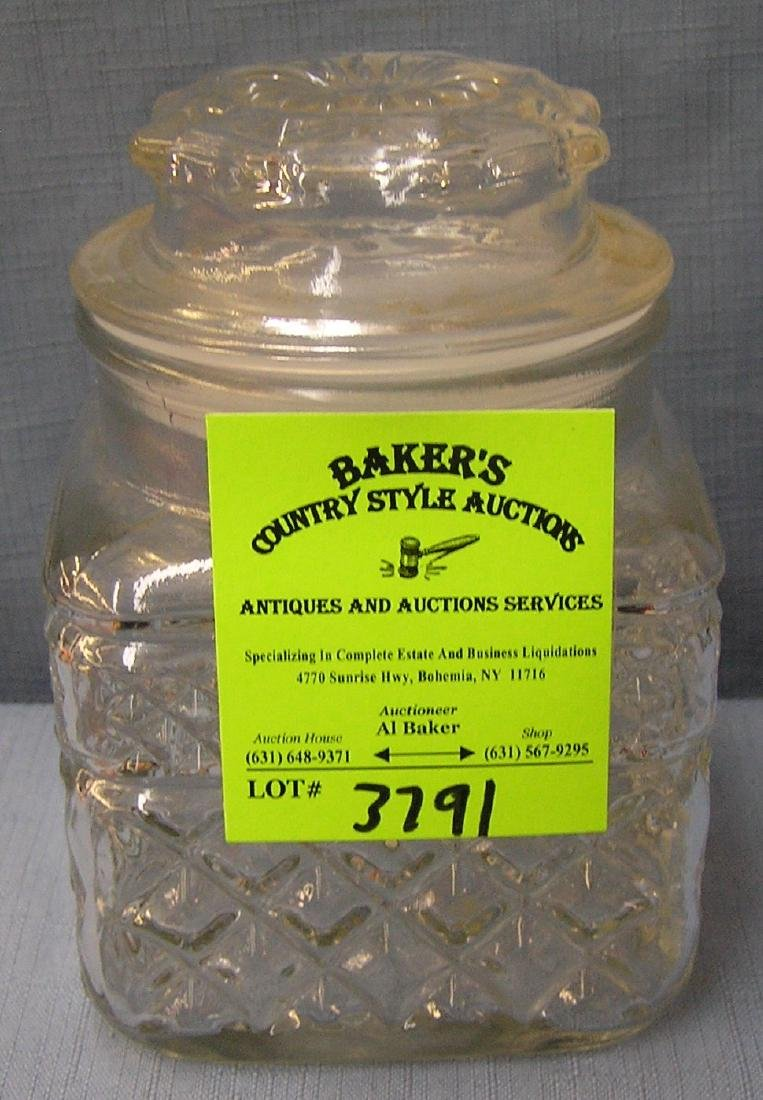 Vintage glass storage jar with cover