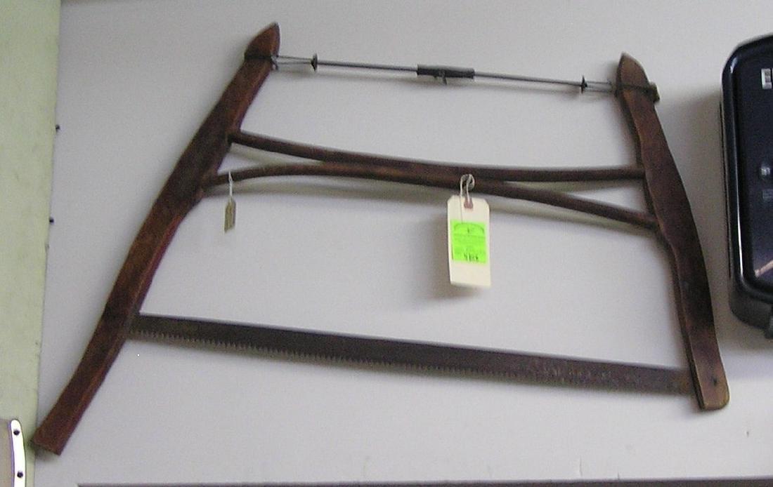 Antique wooden farm saw