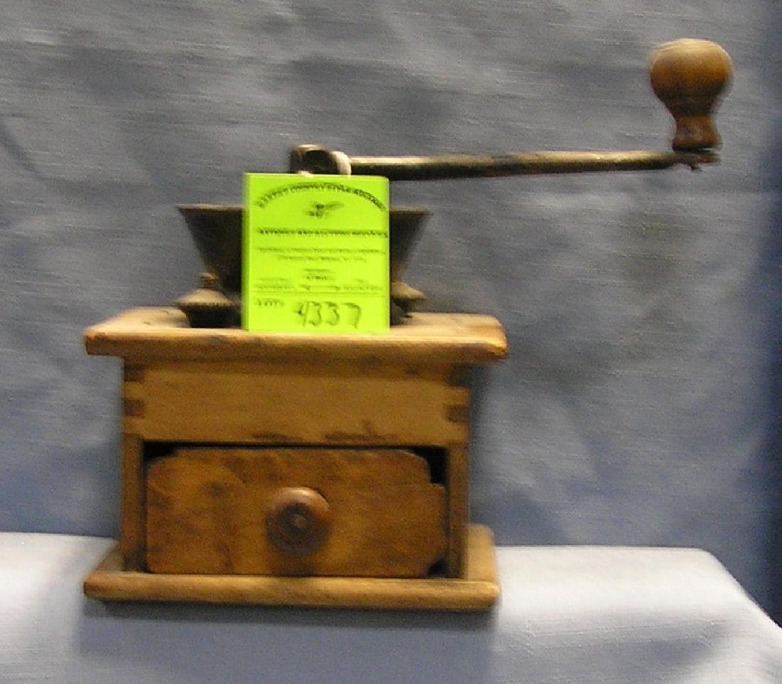 Antique dove tailed coffee grinder
