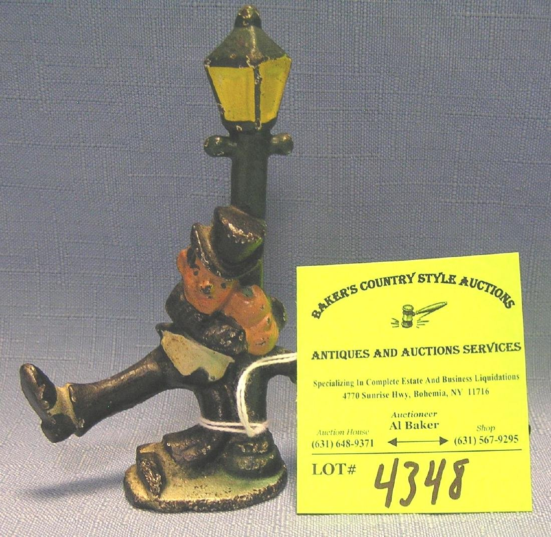 hobo on lamp post figural bottle opener