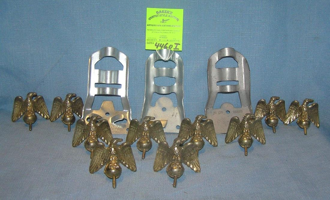 Brass Amer. eagles and metal flagpole holders