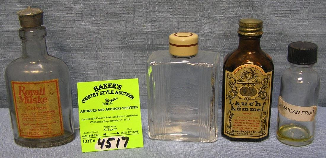 Group of four early perfume and liquor bottles