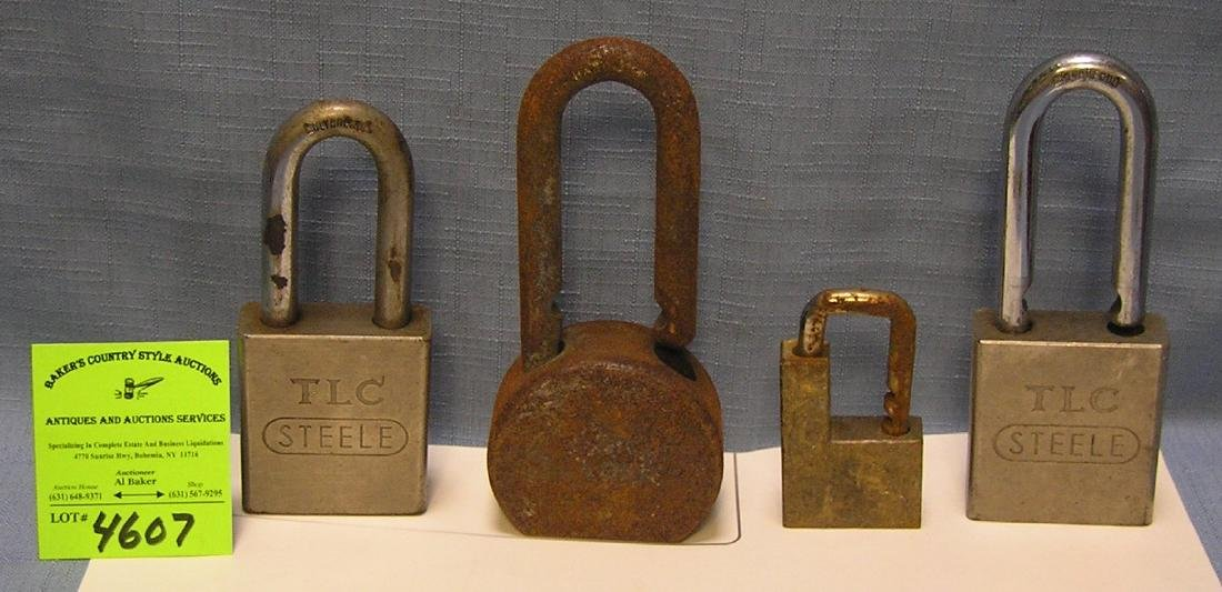 Group of four vintage heavy duty pad locks