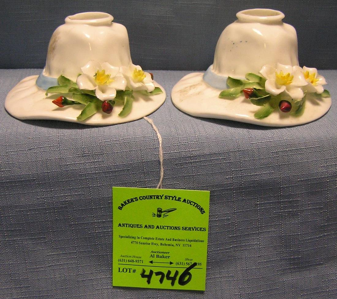 Pair of floral decorated ladies bonnet shaped candle