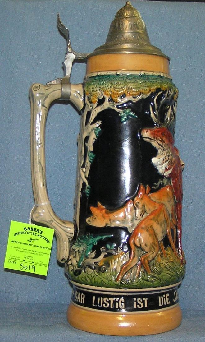 German beer stein with Black Forest theme animals