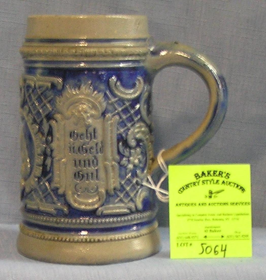 Vintage German beer stein featuring a brew meister
