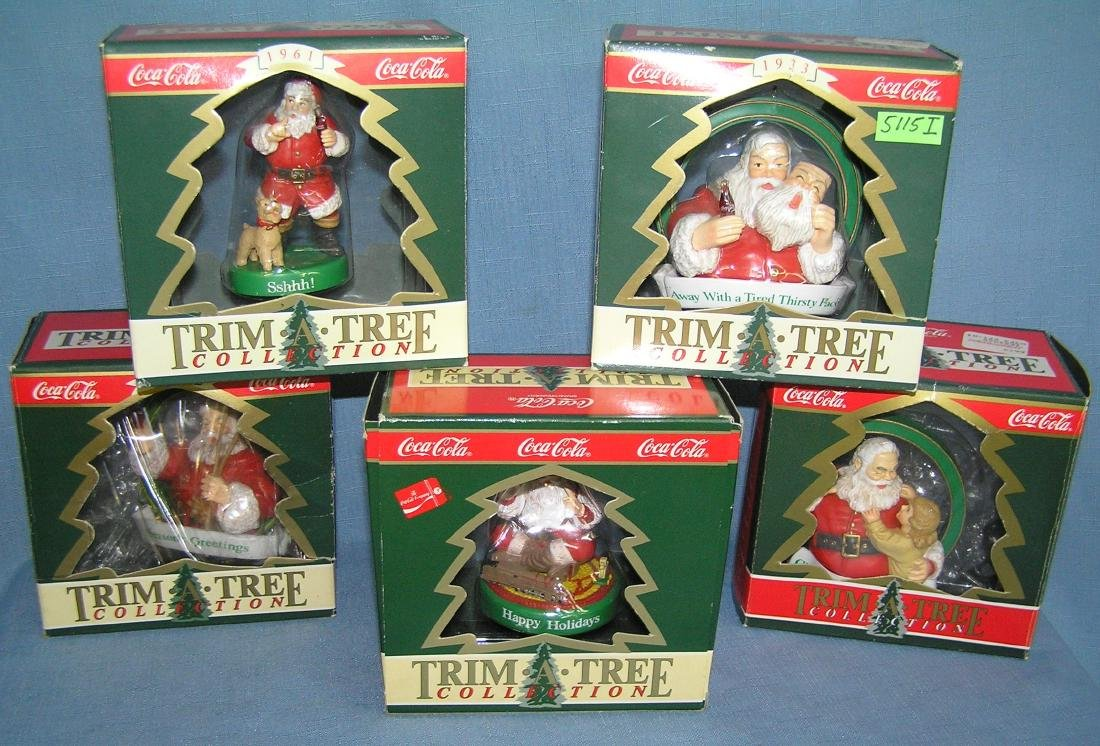Collection of Coca Cola Santa Claus Christmas ornaments