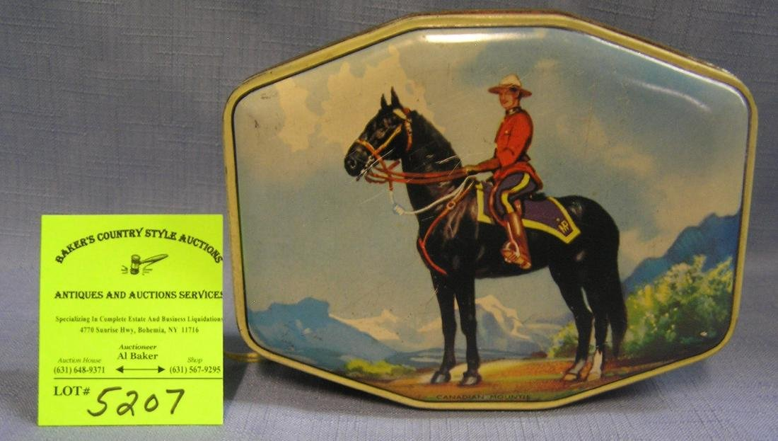 Canadian mounted police figural tin