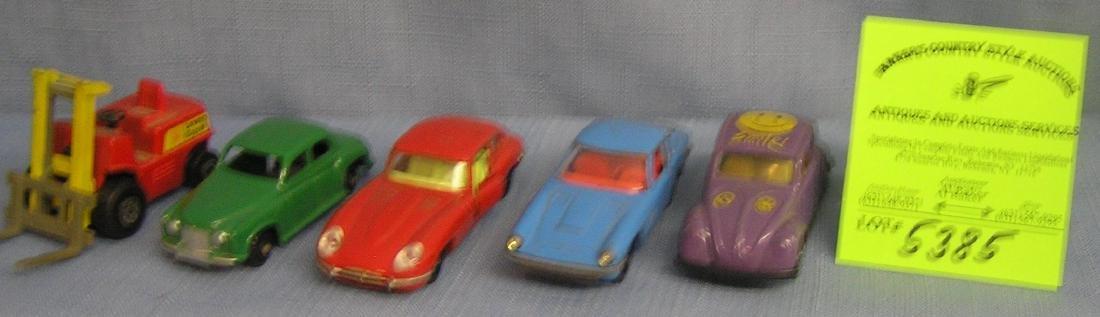 Group of five vintage cast metal vehicles