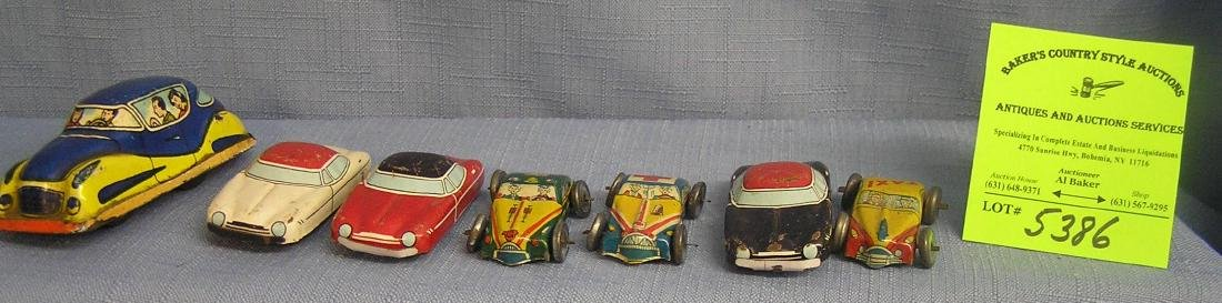 Group of seven vintage all tin vehicles