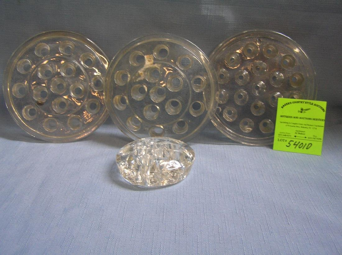 Collection of early glass flower frogs