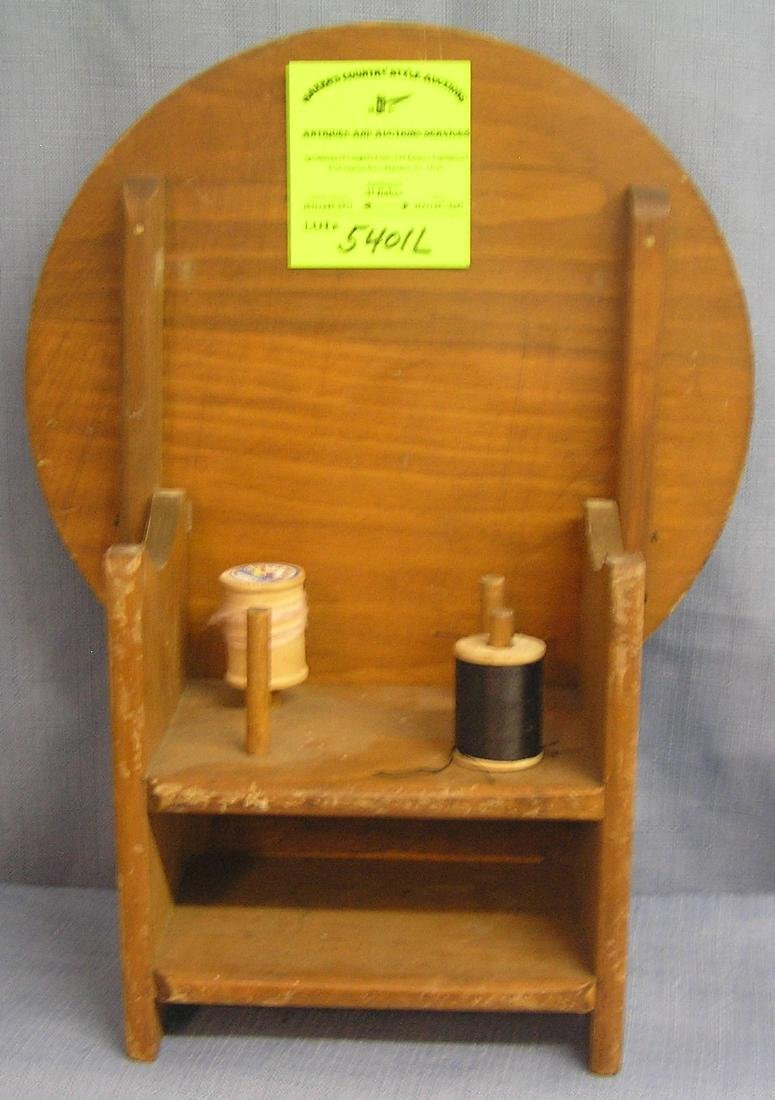 Sewing table spool display and storage piece