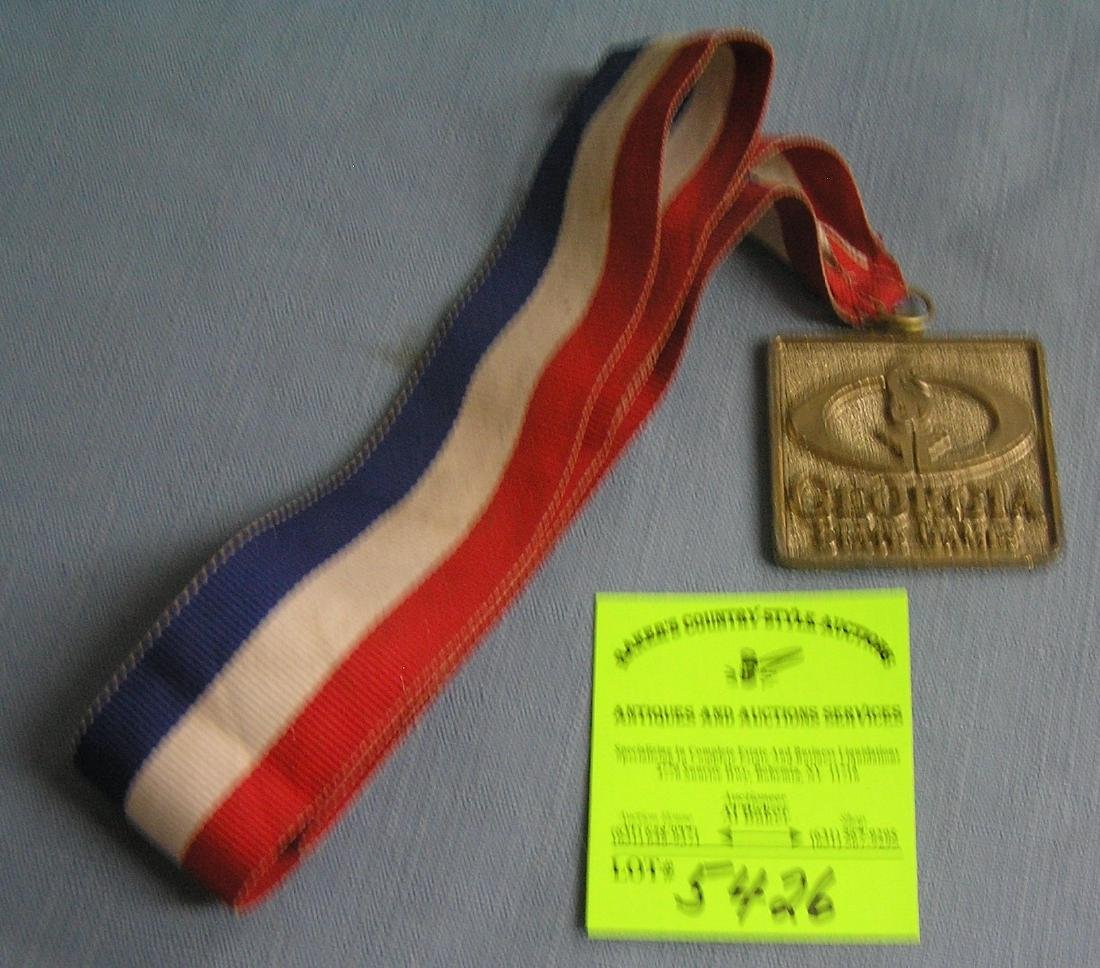 Georgia state Olympic game style medal and ribbon