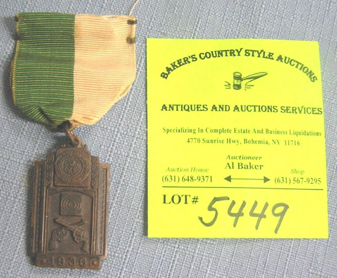 Early policeman's handgun award medal and ribbon