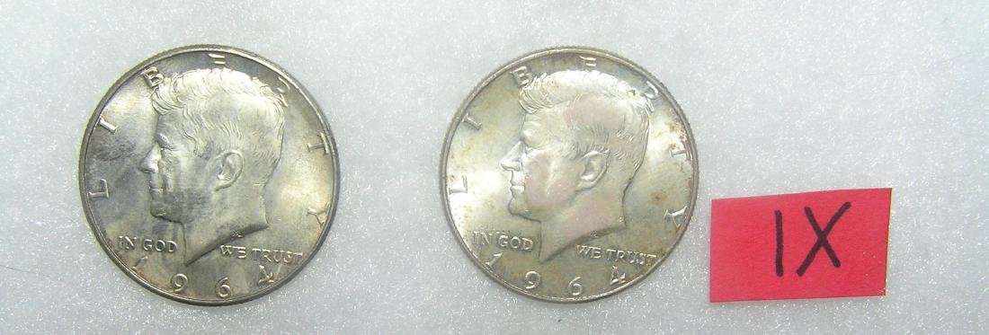 Pair of John F Kennedy silver half dollar coins