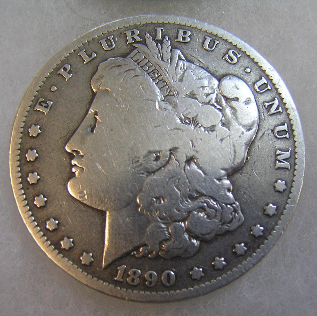 1890-O Morgan silver dollar in very good condition