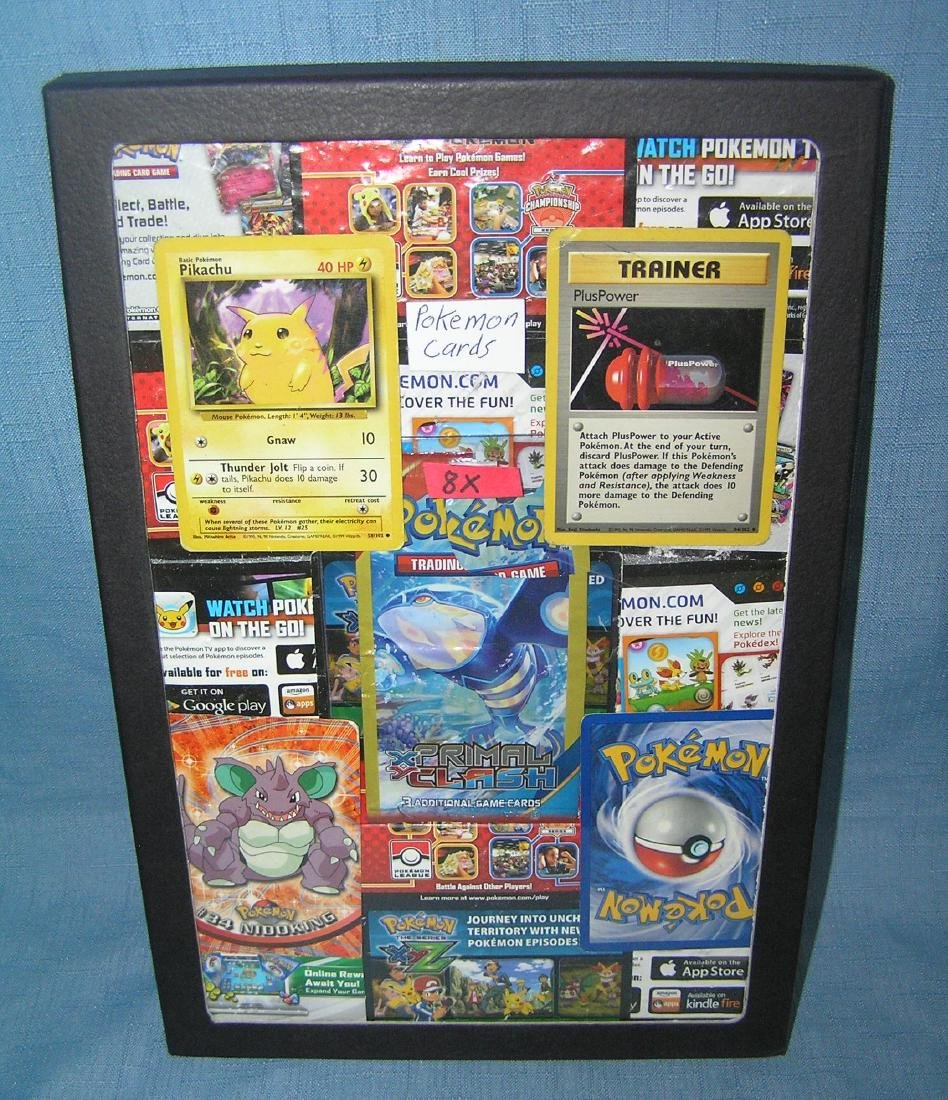 Collection of Pokemon cards and related items