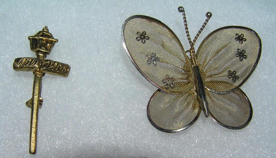 Pair of costume jewelry pins includes lamp post and