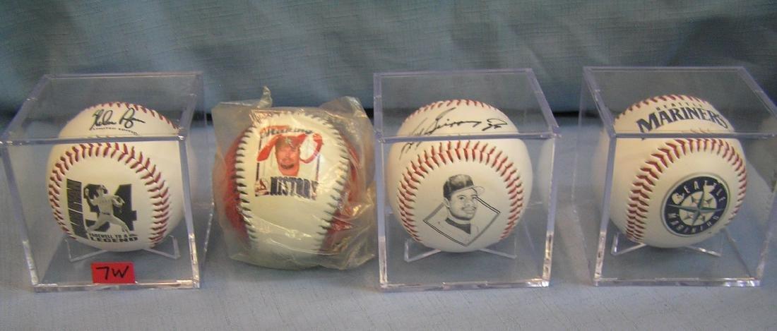 Group of 4 collectible baseballs