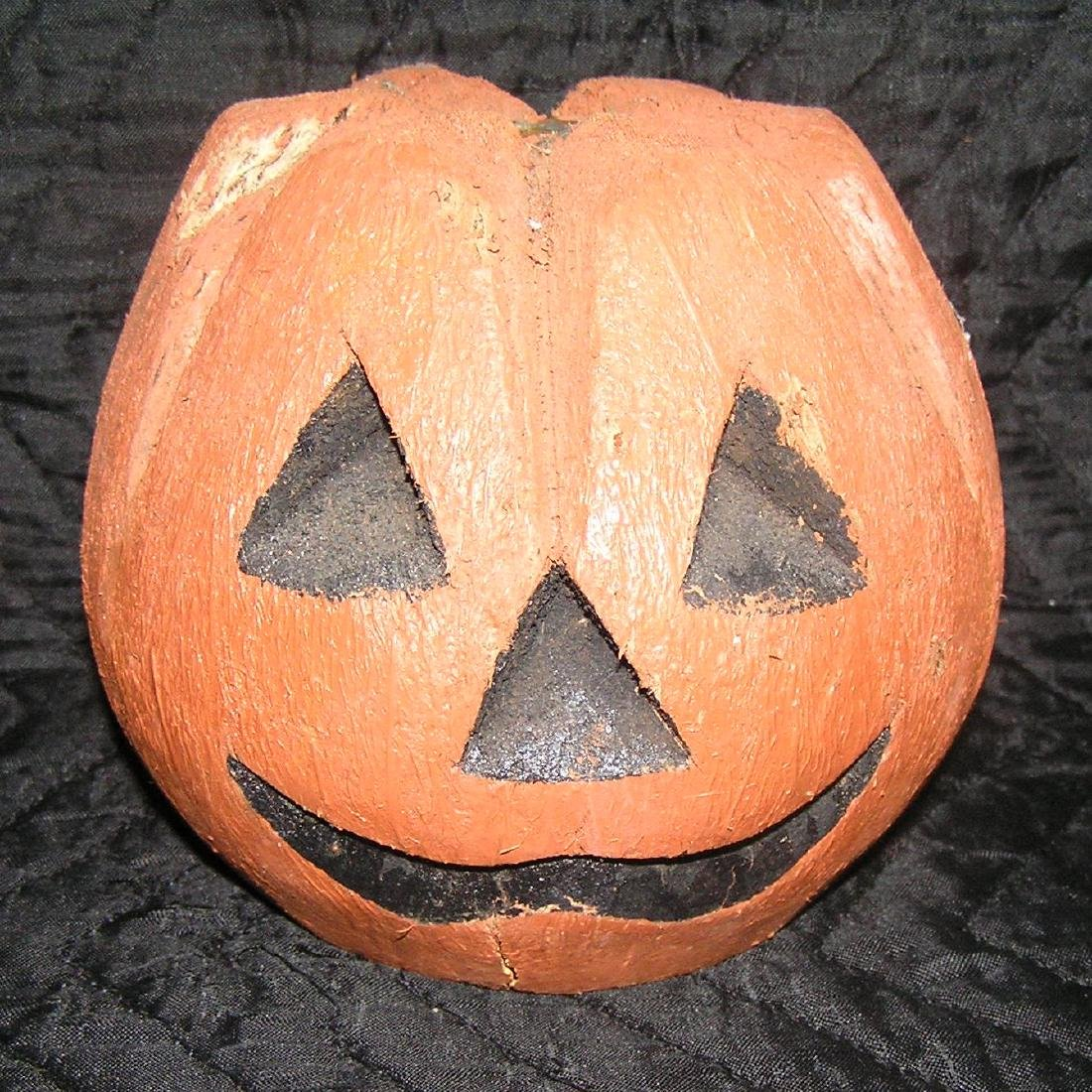 Vintage Jack O Lantern carved from an old coconut