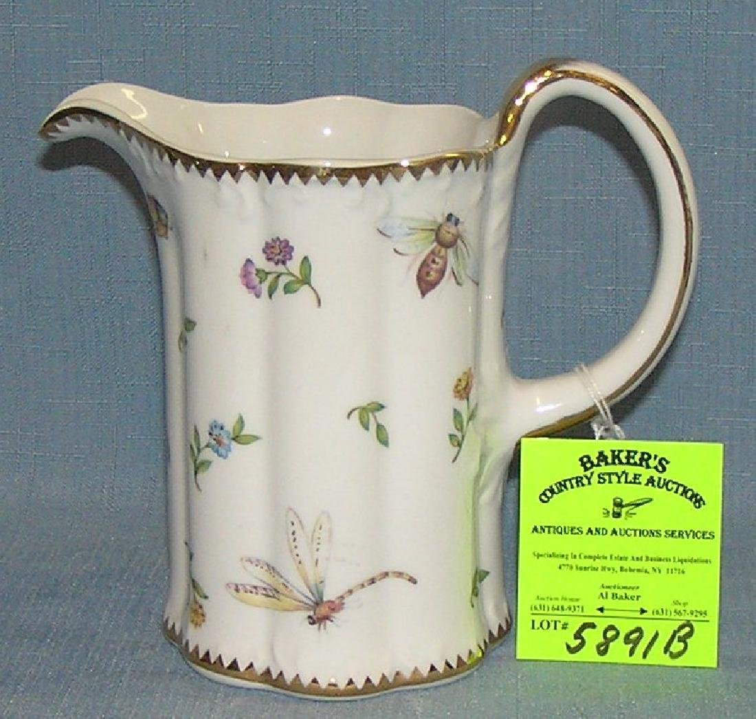Vintage insect and flower decorated water pitcher