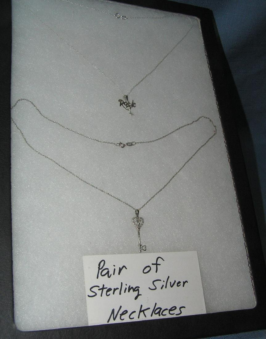 Pair of sterling silver necklaces